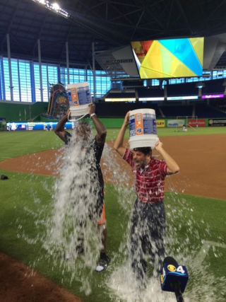 Mike Hill (left) and David Samson (right) take the Ice Bucket Challenge on Tuesday at Marlins Park.